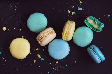 Self adhesive Wall Murals Macarons Macaroons on dark background, colorful french cookies macarons. The broken macarons with crumbs