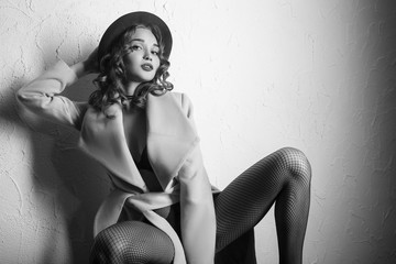 beautiful girl on tights and coat posing, monochrome