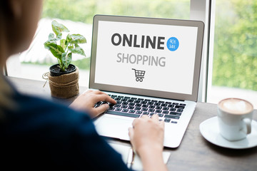 Young woman using laptop computer. Online shopping concept