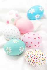 Pastel and colorful easter eggs with copyspace. Happy Easter!.