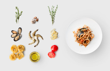 Cooking ingredients for italian food, seafood pasta, isolated on white