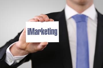 iMarketing / Businessman holding card