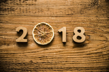 happy new year 2018 wooden digits lie on wooden plank background