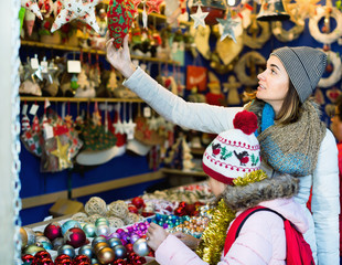 Female customers staring at counter of Christmas market