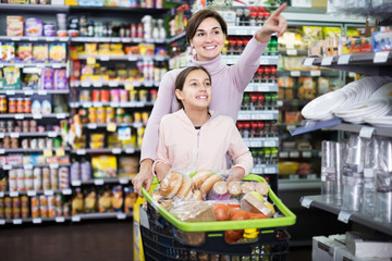 Woman with daughter in supermarket