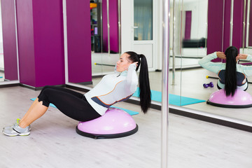 Woman working out with body bar