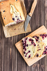 Homemade berry cake on rustic wooden background