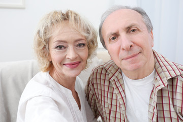 Closeup portrait of happy senior couple at home