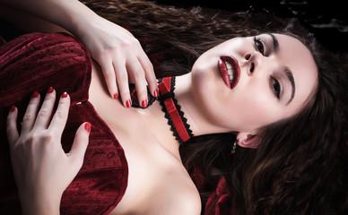 Closeup of portrait beautiful brunette woman in red dress