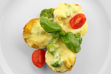 Portion of delicious baked potato with cheese sauce, closeup