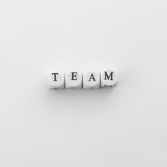 Man hand hold M letter to connect with word Tea spelled by dice. Team work as concept of business idea