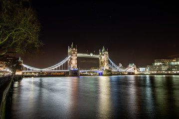 Tower Bridge with reflections in the Thames at night