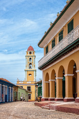 Trinidad, Cuba -March 8, 2016:  Beautiful architecture of Palacio Brunet and the bell tower in Trinidad. in the background.