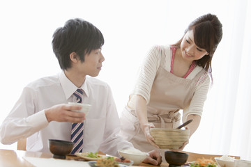 Woman Serving Food to Her Boyfriend