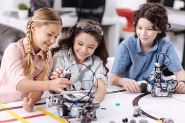 Positive children enjoying science at school