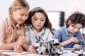 Pleasant children discussing science at school