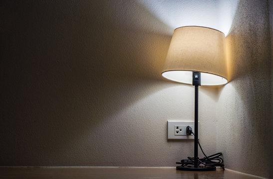 One lamp in dark room
