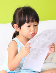 Little girl holding sheet of paper