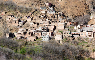 Modest traditional berber village with cubic houses in Atlas mountains, Morocco