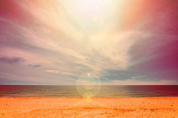 Bright landscape of beach with water and sun flare effect. Hot burned color effect