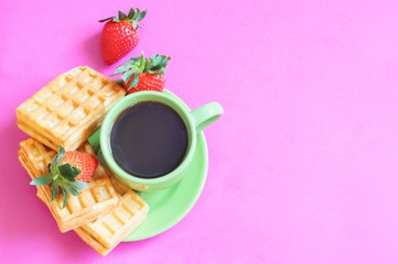 Morning cup of coffee and dessert/ Flat lay photography cup of coffee and waffles with strawberries on a pink background
