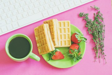 Flat lay breakfast photography/ Cup of coffee, wafers with strawberries. Feminine work place