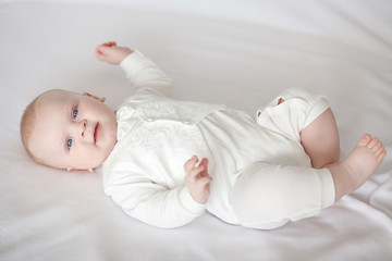 baby in white clothes