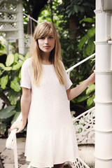 White dress beauty with blond hair, portrait