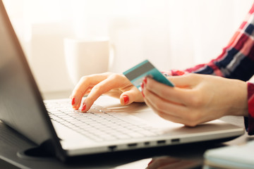 woman making online payment with credit card