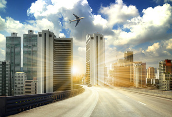 Fotomurales - city road through modern buildings or modern office building background