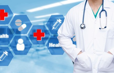 smart doctor with a stethoscope around his neck with healthcare icons on the hospital blurred background, medical technologies concept.