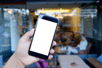Man holding and using Blank screen Smartphone in cafe.