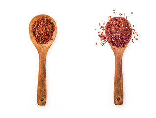 Heap of raw brown rice in wooden spoon on white background