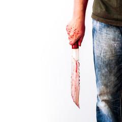 Mad man holds big hunter knife with blood. Criminal scene background with killer or murder person