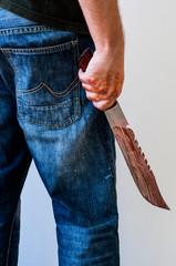 Mad person holds big knife with splash of blood. Murder or killer criminal scene