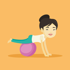 Young woman exercising with fitball.
