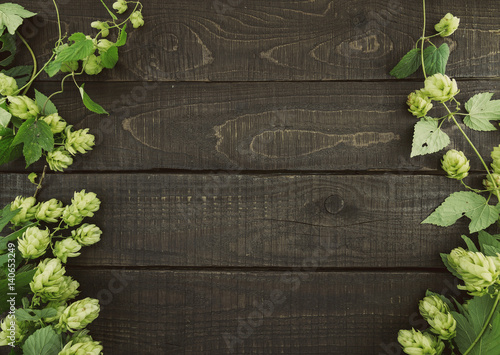 Border From Green Hop Branches On Dark Rustic Wooden Background Concept Of Beer Production