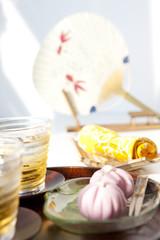 Barley tea, sweet food and fan