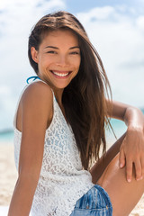 Healthy smiling young Asian woman portrait. Chinese mixed race natural beauty girl posing on beach happy for summer holidays.
