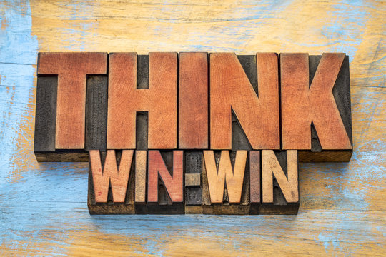 think win-win word abstract in wood type