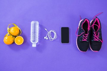 Mobile phone with earphones, shoes, water