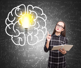 Girl with a book, brain and light bulb