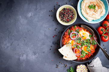 Shakshuka with pita bread and hummus