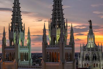 Scenic sunset sky with towers of illuminated Guayaquil Metropolitan Cathedral, Ecuador