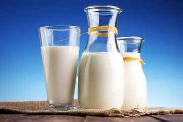 milk products - tasty healthy dairy products on a table on: and milk jar, glass bottle and in a glass