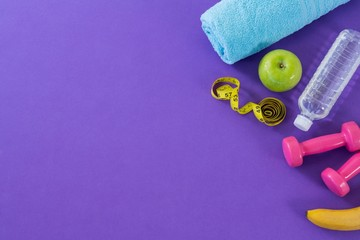Dumbbell, apple, towel, water bottle and measuring tape