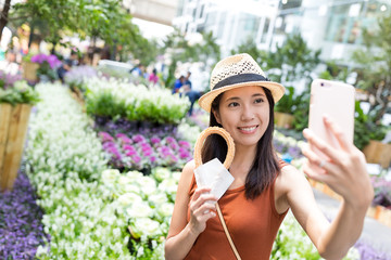 Woman holding Spanish churro and taking selfie