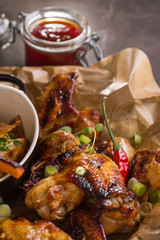 Spicy Chicken Wings with Hot Chili Jam, Baked Potatoes and Purple Carrots