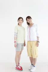 Two young women wearing sportswear