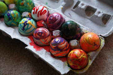 The box filled with abstract painted eggs